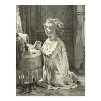 A primeira oração da criança cartao postal
