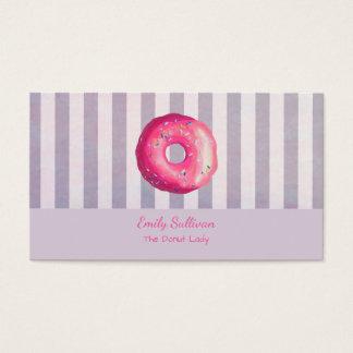 A rosquinha com glacé cor-de-rosa e polvilha cartão de visitas