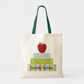 A sacola do professor empilhado dos livros bolsas