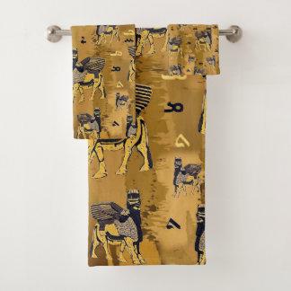 A toalha Assyrian do alfabeto e do lamassu ajustou
