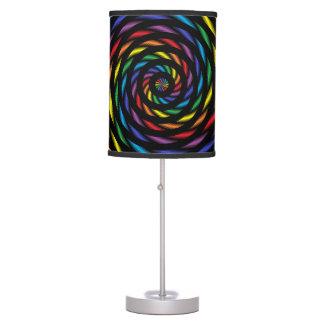 Abajur Um Pinwheel do arco-íris no movimento