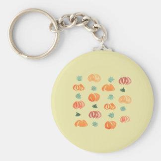 Abóboras com o chaveiro básico do botão das folhas