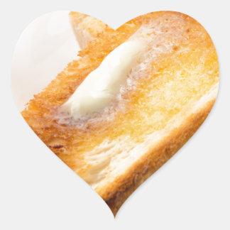 Adesivo Coração Brinde quente com manteiga em um fim-acima branco