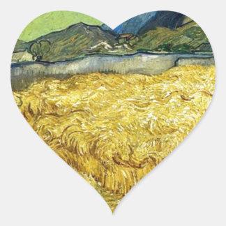 Adesivo Coração Campos de trigo com a ceifeira no nascer do sol -