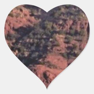 Adesivo Coração colisões e protuberâncias na rocha vermelha
