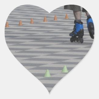 Adesivo Coração Pés da cara em skates inline. Patinadores Inline