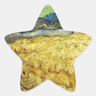 Adesivo Estrela Campos de trigo com a ceifeira no nascer do sol -