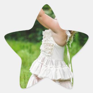 Adesivo Estrela Menina que trava um Butterly