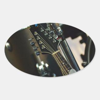 Adesivo Oval A música dos instrumentos rufa o instrumento