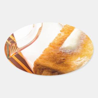 Adesivo Oval Caneca de chá e de brinde quente com manteiga