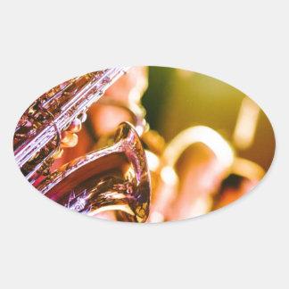 Adesivo Oval Chifres dos saxofones dos instrumentos musicais da
