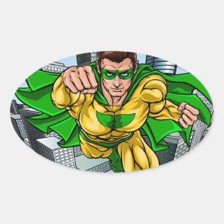 Adesivo Oval Cidade do super-herói do vôo da banda desenhada