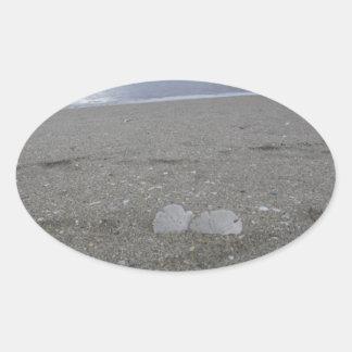 Adesivo Oval Dólares de areia da praia