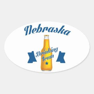 Adesivo Oval Equipe do bebendo de Nebraska