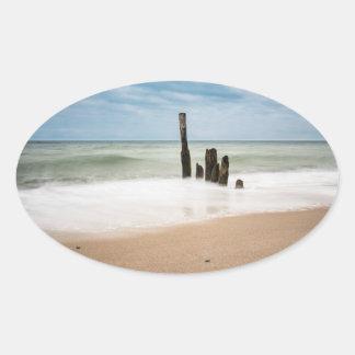 Adesivo Oval Groynes na costa do mar Báltico
