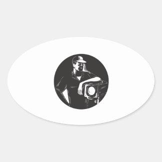 Adesivo Oval Grupo de filme que ilumina o círculo Woodcu do