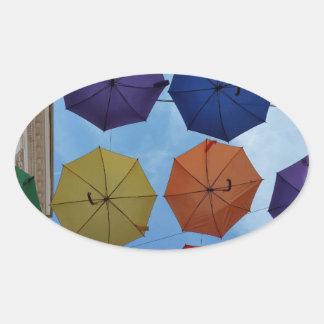 Adesivo Oval Guarda-chuvas coloridos