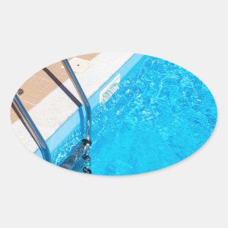 Adesivo Oval Piscina azul com escada