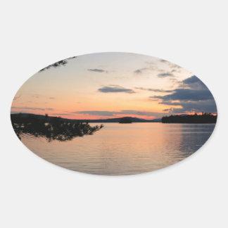 Adesivo Oval Por do sol sobre o lago Maine Millinocket da ilha