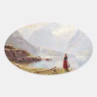 Adesivo Oval Rapariga ao lado do fiorde