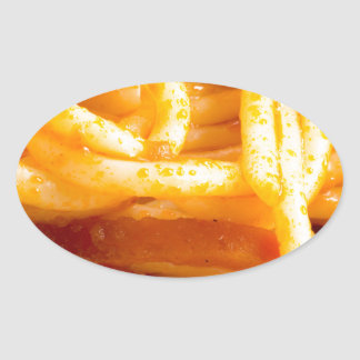 Adesivo Oval Vista macro detalhada nos espaguetes cozinhados em