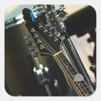 Adesivo Quadrado A música dos instrumentos rufa o instrumento