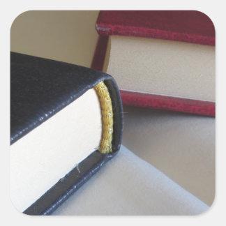 Adesivo Quadrado A segunda mão registra com páginas vazias em uma