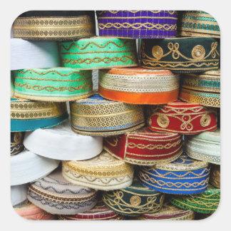 Adesivo Quadrado Bonés árabes no mercado