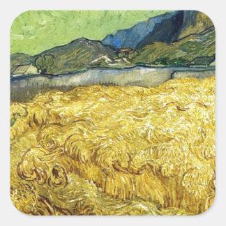 Adesivo Quadrado Campos de trigo com a ceifeira no nascer do sol -