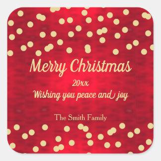 Adesivo Quadrado Confetes do ouro no teste padrão vermelho do Natal