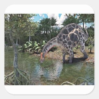 Adesivo Quadrado Dinossauro do Dicraeosaurus que alimenta em um rio
