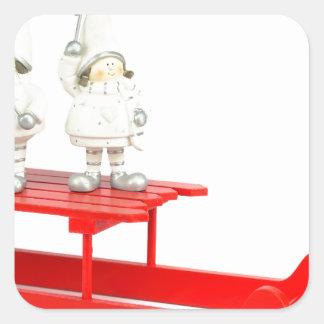 Adesivo Quadrado Estatuetas do Natal das crianças no trenó vermelho