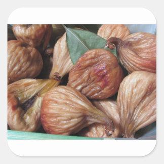 Adesivo Quadrado Frutas do outono. Close up de figos secados com