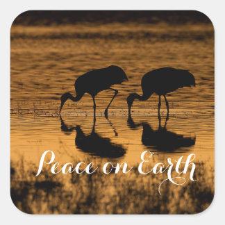 Adesivo Quadrado Guindastes e paz na terra