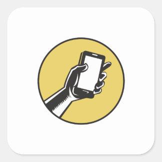 Adesivo Quadrado Mão que guardara o Woodcut do círculo de