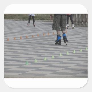 Adesivo Quadrado Pés da cara em skates inline. Patinadores Inline