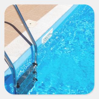 Adesivo Quadrado Piscina azul com escada