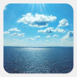 Adesivo Quadrado Raios sobre o mar