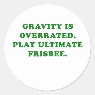 Adesivo Redondo A gravidade é Frisbee final avaliado em excesso do