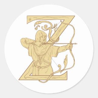 Adesivo Redondo Arqueiro medieval que aponta o desenhar da letra Z