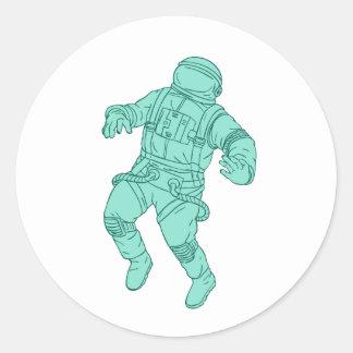 Adesivo Redondo Astronauta que flutua no desenho do espaço