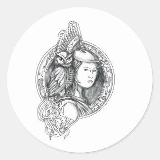 Adesivo Redondo Athena com a coruja no Cir do circuito eletrônico