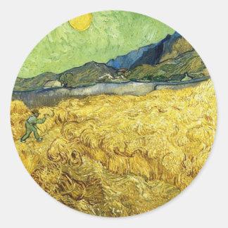 Adesivo Redondo Campos de trigo com a ceifeira no nascer do sol -