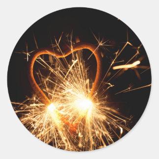 Adesivo Redondo Foto macro de um sparkler ardente no formulário de