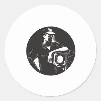 Adesivo Redondo Grupo de filme que ilumina o círculo Woodcu do