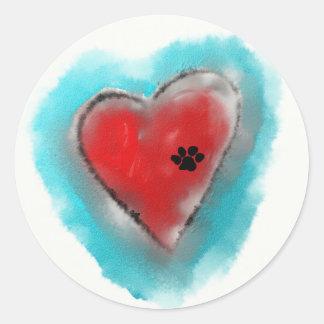 Adesivo Redondo Impressão da pata deixado em um coração