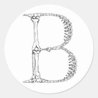 Adesivo Redondo Inicial do osso da letra B