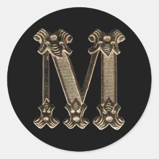 Adesivo Redondo Inicial ou monograma dourado da letra M no preto