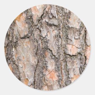 Adesivo Redondo Latido do pinheiro escocês como o fundo