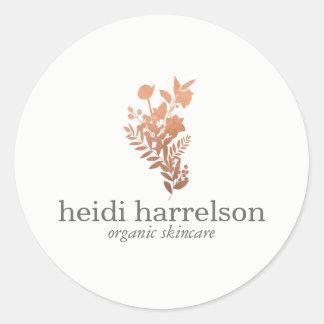 Adesivo Redondo Logotipo floral do ouro cor-de-rosa no branco